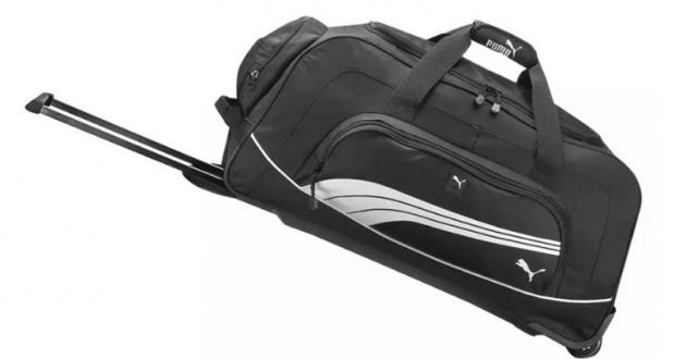 Un sac de voyage à roulettes de la compagnie Puma
